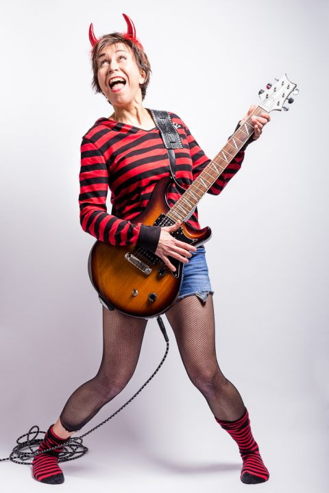 woman playing the electric guitar